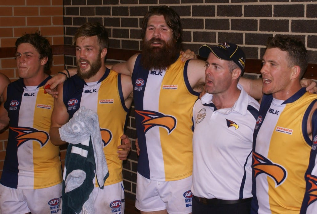 The bearded Andrew Browning leads the East Coast Eagles victory song.  Picture courtesy of Mark Spiteri.
