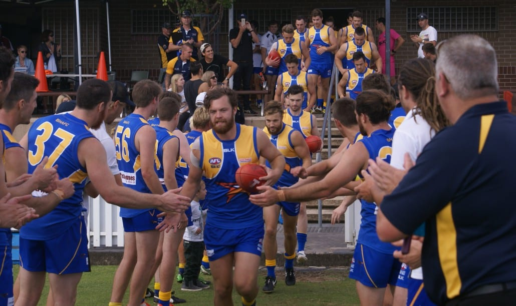 Jack Dimery leads out the Eagles in his 100th game.  Picture courtesy of Mark Spiteri.